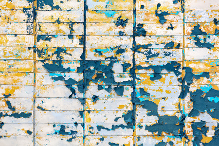 tiled wall: abstract colorful background of rusty tiled wall with peeling paint Stock Photo