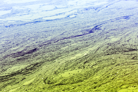 effluent: river with naturally damaged and polluted striped yellow water Stock Photo