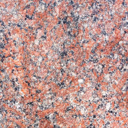 mottled: natural red mottled granite texture as background