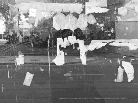 advertisements: torn paper posters and advertisements on glass wall background