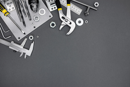 standard steel: set of different metal tools and instruments over grey background Stock Photo