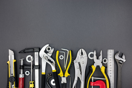standard steel: different tools and instruments for home renovation on grey background