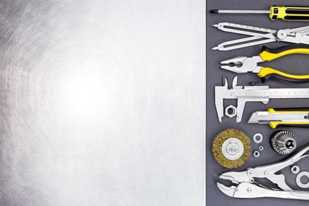 vernier caliper: tool set of wise grips, vernier caliper, pliers and screwdriver on dark gray background