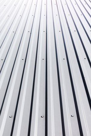 corrugated steel: gray corrugated steel roof with rivets on industrial building