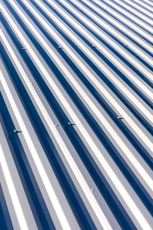 corrugated steel: corrugated steel with bolts for roofing on industrial buildings