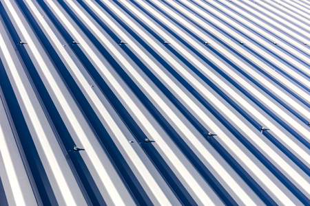 corrugated metal sheet roof background texture in sunlight photo