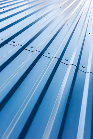 aluminum texture: blue corrugated steel roof with rivets, industrial background Stock Photo