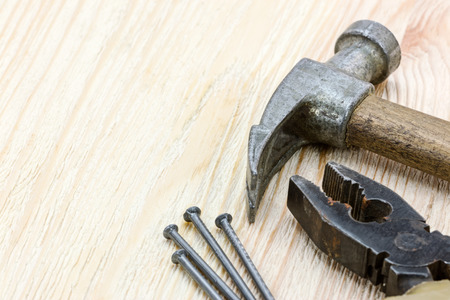 hammer and nails: various old hand tools and instruments. hammer, nails and pliers macro view. Stock Photo