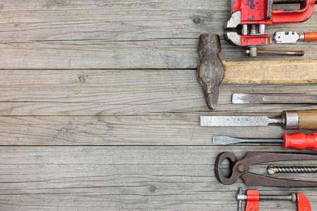 vice grip: old rusty hand tools and instruments on wooden background