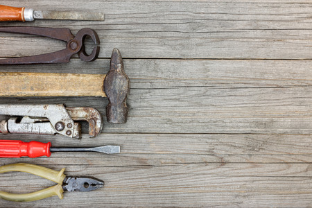 vice grip: set of old tools and instrument for hand work on wooden boards table background