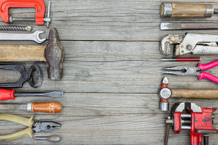 vice grip: various old rusty tools and instrument for manual work and construction on wooden boards table background