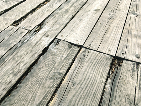 wornout: old ragged worn-out wooden floor boards with checks texture background