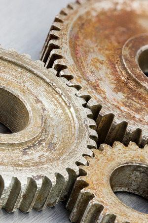 antique factory: rusty brown metal gear cogwheels. industrial background. Stock Photo