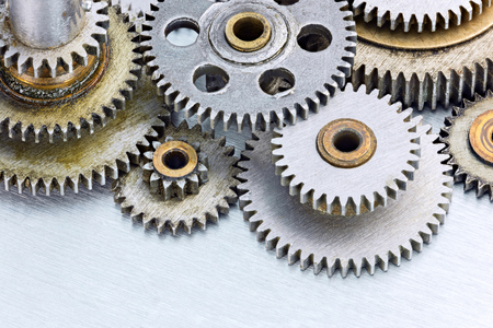 copper texture: set of various old metal machinery gears on scratched background closeup Stock Photo