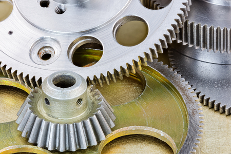 metal gear cogwheels and pulleys for industry closeup