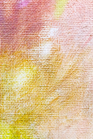 abstract hand painted canvas background in orange and yellow colors