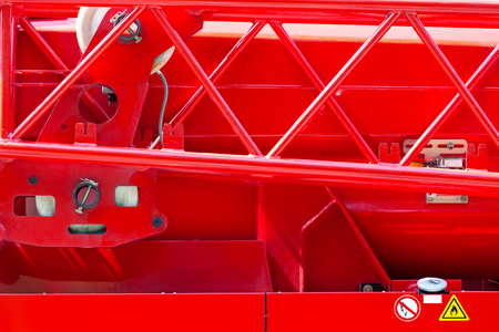 details of rescue firefighting truck. closeup of body of a fire engine in sunlight.  Stock Photo