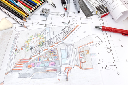 designers workplace with colored hand painted sketch of a living room and drawing tools 版權商用圖片