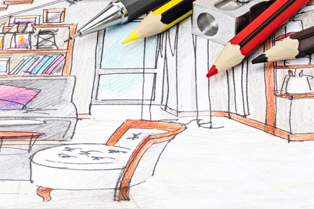 living room design: pencils and sharpener on designers graphical sketch for furniture blueprint closeup