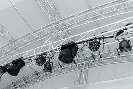 professional stage spotlight equipment. multiple spotlights on outdoor stage.