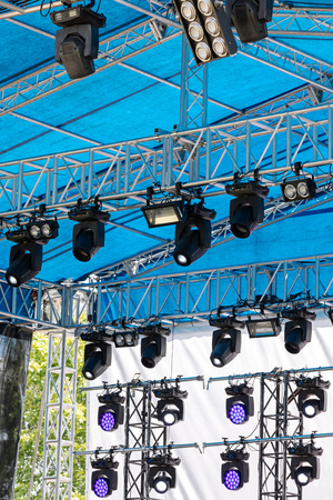 concert spotlight system of outdoor stage under blue roof