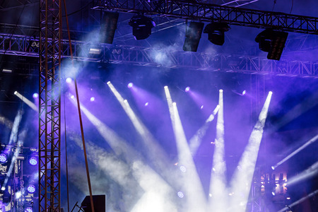 lights beams on stage. blue stage lights at concert. bright spotlights shining down. Archivio Fotografico