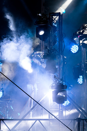 modern LED spotlights illuminating smoky stage with blue lights