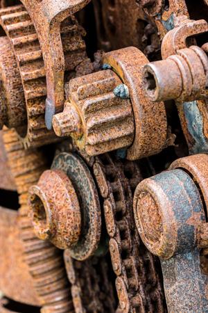 polea: grunge metal machinery details closeup. old rusty gear wheels.