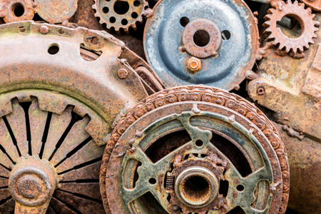 rusty gearwheels and other components of industrial machine