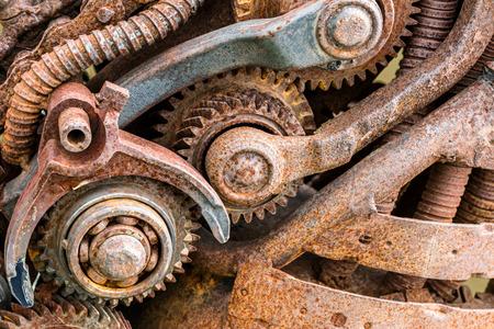 polea: old rusty industrial machinery with gear wheels closeup Foto de archivo