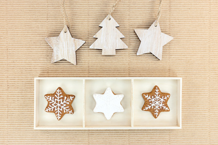 stock photo wooden christmas tree decorations and gingerbreads in box over corrugated brown cardboard