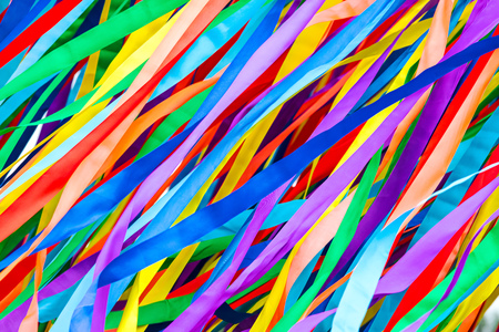 Long multicolored ribbons is fluttering in the wind. festive colorful background.