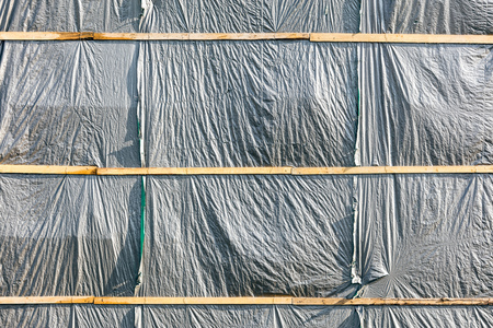 Gray Tarp Covering A Building For Backgrounds Stock Photo Picture