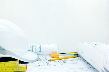 architects and engineering desk view. construction concept. drawing and measuring tools on table.