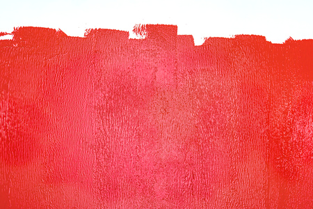 partly painted wall in red colors. renovation home concept 스톡 콘텐츠