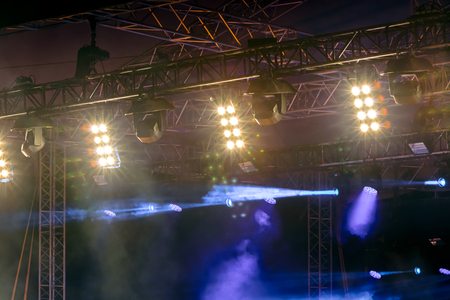 row of bright spotlights on concert stage. outdoor performance Standard-Bild