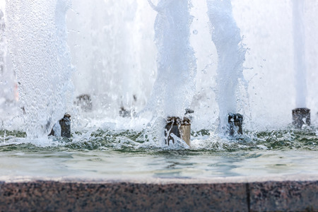 splashes of fountain water with bubbles on surface. detail closeup