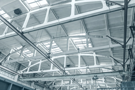 roof of industrial building. view from inside. ceiling with rafters and beams