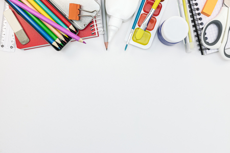 school stationary on white background with copy space, flat view