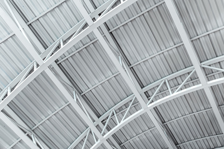 industrial corrugated metal ceiling structure with metal truss frame Stock Photo