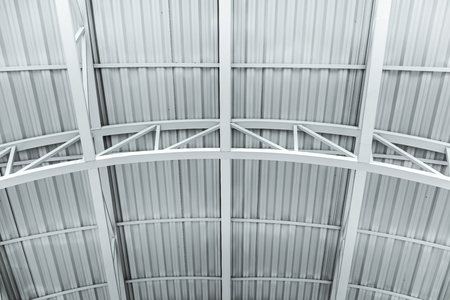 ceiling of the industrial building. metal structure of warehouse roof Stock Photo