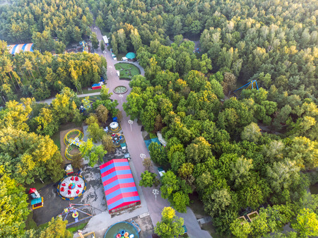 aerial top vie of city central park. amusement attractions among green trees