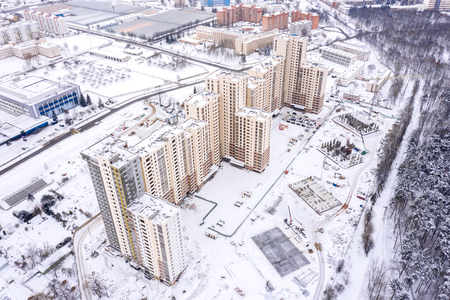aerial top view of new city residential area under construction, buildings in winter Imagens