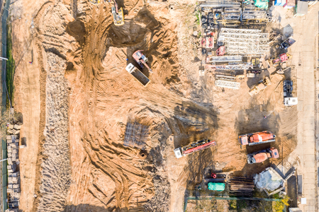 various heavy building machines working at construction site. aerial top view