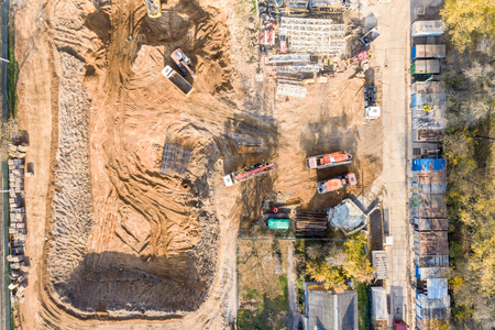 aerial top view of construction site with heavy industrial machinery for ground work