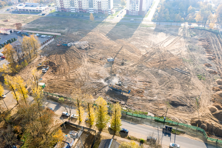 aerial top view of site being prepared for construction of new residential area Stock Photo