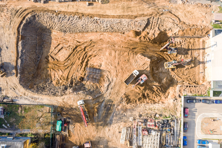aerial top view of ground foundation works at city construction site