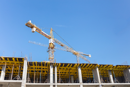view of construction site. development of new residential area. tower cranes against blue sky background
