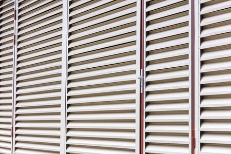 exterior view of warehouse building. vent wall pattern. abstract striped background of metal louvers 版權商用圖片