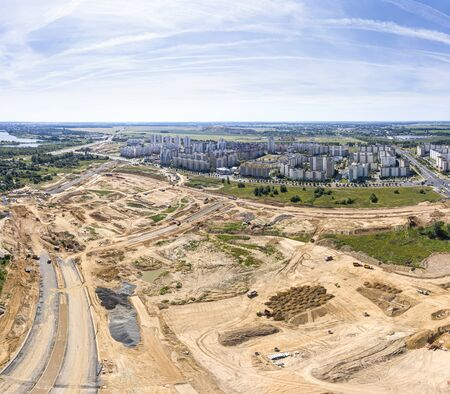 aerial view panorama of construction site near city residential area